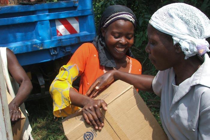 People receiving Breedlove food as part of international aid.