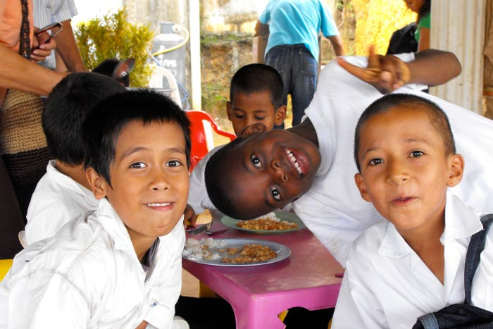 Young boys enjoying nutritious food from Breedlove Food aid packages.