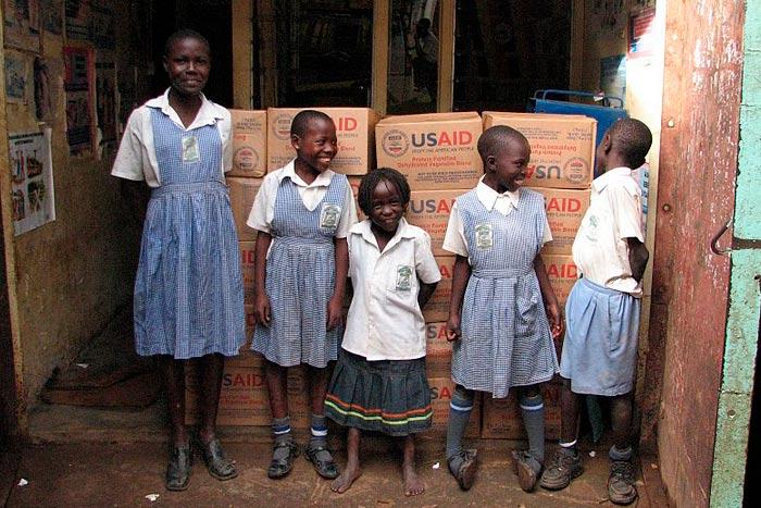 Children standing in front of Breedlove food shipment.
