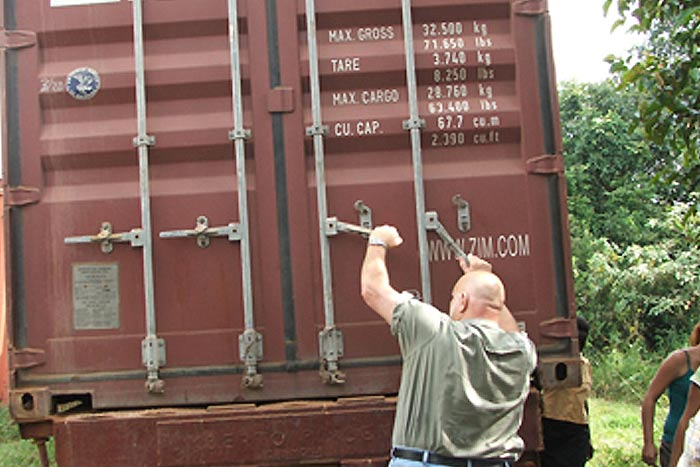 Aid relief staff opening rail car of Breedlove Foods shipment.