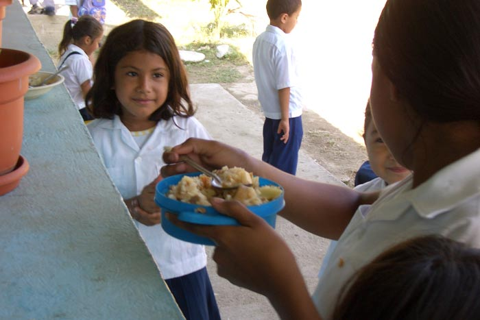 Children happy to receive a warm, nutritious meal.