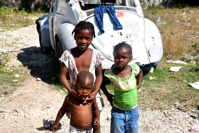 Children in Haiti stricken by poverty and disaster.