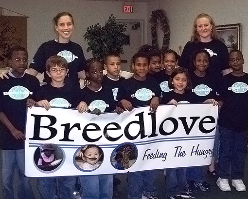 Group of school children with teachers after Breedlove fundraising campaign.